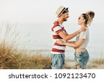 young couple at the beach | Shutterstock . vector #1092123470