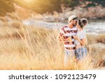 young couple kissing at the... | Shutterstock . vector #1092123479