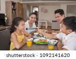 little asian boy feeding his... | Shutterstock . vector #1092141620