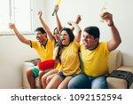 group of friends watching... | Shutterstock . vector #1092152594