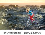 young tourist cycling on lava... | Shutterstock . vector #1092152909
