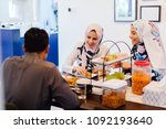 a muslim family sits down for a ... | Shutterstock . vector #1092193640