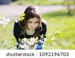 adorable kid girl in blooming... | Shutterstock . vector #1092196703