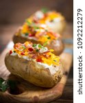 baked potatoes with cheese and... | Shutterstock . vector #1092212279