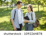 young student couple walking in ... | Shutterstock . vector #1092264878