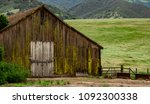 an old weathered moss covered... | Shutterstock . vector #1092300338