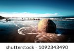 dunedin boulders in sunset | Shutterstock . vector #1092343490