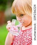cute little girl drinking water ... | Shutterstock . vector #109236224