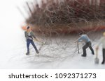 workers are cleaning hair loss... | Shutterstock . vector #1092371273