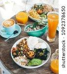 eggs benedict served with salad ...   Shutterstock . vector #1092378650