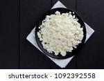 cottage cheese on a dark wooden ... | Shutterstock . vector #1092392558