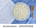 cottage cheese on a white blue... | Shutterstock . vector #1092393968