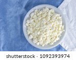 cottage cheese on a white blue... | Shutterstock . vector #1092393974