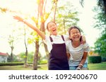 two asian teenager laughing... | Shutterstock . vector #1092400670
