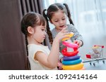 children girls play a toy games ... | Shutterstock . vector #1092414164