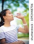asian teenager drinking water... | Shutterstock . vector #1092448706
