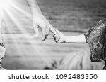 beautiful hands of parent and... | Shutterstock . vector #1092483350