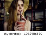 woman with a plastic glass in... | Shutterstock . vector #1092486530
