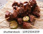 barbecue skewers with juicy... | Shutterstock . vector #1092504359