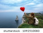 happy girl with a red balloon... | Shutterstock . vector #1092510083