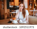beautiful girl in cafe with... | Shutterstock . vector #1092511973