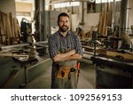 carpenter working at his... | Shutterstock . vector #1092569153