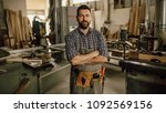 carpenter working at his... | Shutterstock . vector #1092569156