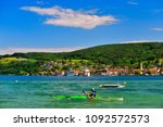 a kayaker on lake constance on... | Shutterstock . vector #1092572573