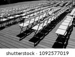 rows of white empty folding... | Shutterstock . vector #1092577019