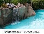Waterfall Falling In A Blue...