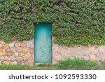 green door on the wall with... | Shutterstock . vector #1092593330