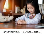 cute girl smile sitdown and... | Shutterstock . vector #1092605858