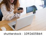 young businesswoman working... | Shutterstock . vector #1092605864