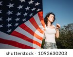 girl with an american flag.... | Shutterstock . vector #1092630203