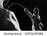 two women wearing helmets and... | Shutterstock . vector #1092639386