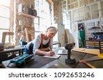 senior craftswoman in her... | Shutterstock . vector #1092653246