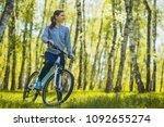 cute woman cyclist cycling... | Shutterstock . vector #1092655274