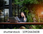 young woman wearing smartwatch... | Shutterstock . vector #1092663608