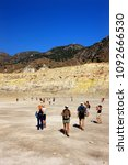 Small photo of NISYROS ISLAND, GREECE- June 14, 2008. Tourists walking on the surface of Stefanos crater, in the volcano of Nisyros island, Dodecanese, Aegean sea.