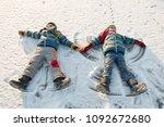 happy boys in colorful winter... | Shutterstock . vector #1092672680