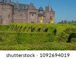 garden and muiderslot castle at ... | Shutterstock . vector #1092694019