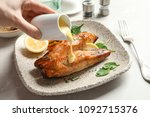 woman pouring sauce onto tasty... | Shutterstock . vector #1092715376