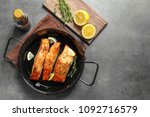 dish with tasty cooked salmon... | Shutterstock . vector #1092716579