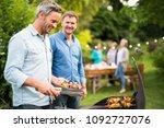 n a summer evening   two men ...   Shutterstock . vector #1092727076