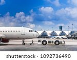 plane being pushed back at the... | Shutterstock . vector #1092736490