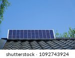 Small photo of Solar panel / cell mounted on a rooftop. Concept of self-sufficiency, self-supporting, self-sustaining and eco-friendly.