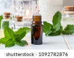 a bottle of essential oil with... | Shutterstock . vector #1092782876