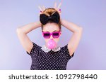 humorous portrait of a young... | Shutterstock . vector #1092798440