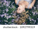 young and happy blond woman in... | Shutterstock . vector #1092799319