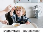 a family breakfast  a small... | Shutterstock . vector #1092836000
